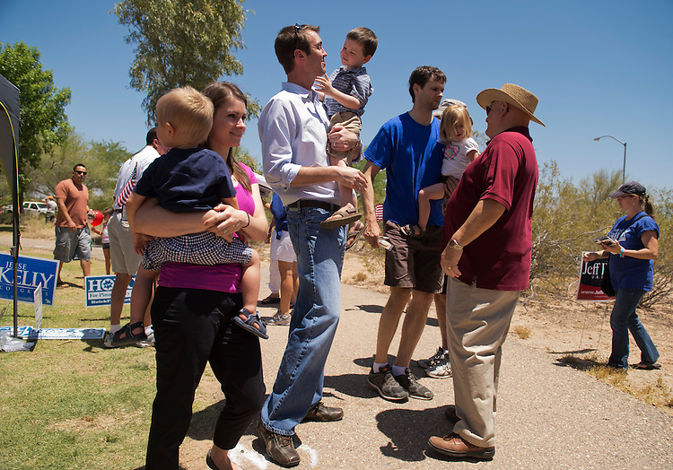 UNITED STATES - MAY 26:  Jesse Kelly, center, republican contender in the AZ-08 special election, holds his son James, 3, at the Rita Ranch Family Fun Day in Tucson, Ariz.  The winner of the election on June 12th will fill the seat occupied by former Rep. Gabrielle Giffords, D-Ariz.  Kelly's wife Aubrey and son Luke, appear at left. (Photo By Tom Williams/CQ Roll Call)