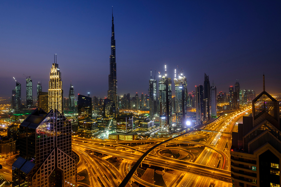 UNITED ARAB EMIRATES, DUBAI - CIRCA JANUARY 2017: Sheikh Zayed Road and Burj Khalifa at dawn in Dubai. This is the main artery of the city and is home for most of the Dubai skyscrapers.