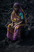 Laccho Devi, a daily wage labourer poses for a portrait in Goladi coal depot in Jharia, outside of Dhanbad in Jharkhand, India.  Photo: Sanjit Das/Panos