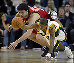 Seattle Supersonics' Earl Watson, right, knocks the ball away from Atlanta Hawks' Zaza Pachulia, from the Republic of Georgia in the third period at Key Arena in Seattle December 5, 2006. The Sonics beat the Hawks 102-87. (UPI Photo/Jim Bryant)