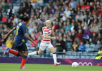 Glasgow, Scotland - Saturday, July 28, 2012: Megan Rapinoe of the USA Women's soccer team carries the ball during a 3-0 win over Colombia in the first round of the Olympic football tournament at Hamden Park.
