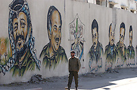 Gaza, Palestine.   A man walks by the Wall of Leaders in downtown Gaza city.  Days after the end of Operation Cast Lead by the Israeli army inside the Gaza strip.  The conflict resulted in between 1,166 and 1,417 Palestinian and 13 Israeli deaths (4 from friendly fire).    (PHOTO: MIGUEL JUAREZ LUGO)
