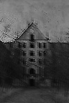 A haunted abandoned place in black and white with some distortion and crows flying arround