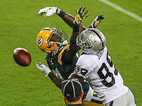 GREEN BAY - August 2014: Davon House (31) of the Green Bay Packers during a game against the Oakland Raiders on August 22nd, 2014 at Lambeau Field in Green Bay, Wisconsin.  (Photo Credit: Brad Krause)