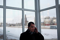 Bashneft employee Ruslan Yusupov speaks on a cell phone at a Bashneft refinery outside of Ufa, Bashkortostan, Russia. The area is a major oil and gas producing region in the country.