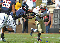 Oct 2, 2010; Charlottesville, VA, USA; Florida State Seminoles cornerback Greg Reid (5) is tackled by Virginia Cavaliers safety Trey Womack (1) during the game at Scott Stadium. Florida State won 34-14.  Mandatory Credit: Andrew Shurtleff-