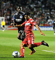 Chicago Fire defender Deris Umanzor (13) clears the ball in front of San Jose midfielder Brandon McDonald (14) during the second half of a match between the San Jose Earthquakes and the Chicago Fire at Toyota Park in Bridgeview, IL on April 10, 2010.  San Jose Earthquakes 2, Chicago Fire 1.