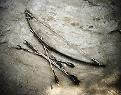 A traditional bow and arrow is laid out for a photo in Balighato village of Kalinga Nagar industrial area in Orissa, India.