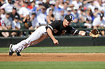 CHICAGO - JUNE 27:  Gordon Beckham #15 of the Chicago White Sox dives but cannot catch a ground ball against the Chicago Cubs on June 27, 2009 at U.S. Cellular Field in Chicago, Illinois.  The White Sox defeated the Cubs 8-7.   (Photo by Ron Vesely)