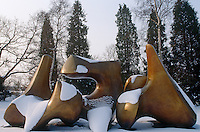 In the garden a drift of snow on the curved planes of a large bronze sculpture accentuates its shape and colour