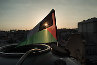 Palestinian flag at sunset on the rooftop of the Shatila camp in Beirut. Shatila, Lebanon. August 2015