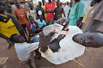 Men play cards in the Ajuong Thok Refugee Camp in South Sudan. Situated in northern Unity State, the camp hosts thousands of refugees from the Nuba Mountains, located across the nearby border with Sudan. The ACT Alliance provides a variety of services in the camp.