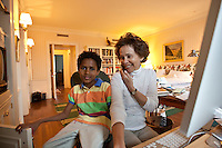 8 year-old Danny Hodes looks at the photographer as Marilyn Berger (R), Don Hewitt's widow, speaks on the phone in her apartment in New York, NY, USA, 9 April 2010. Ms Berger met him in Addis Ababa, Ethiopia while reporting there and helped him get surgery.