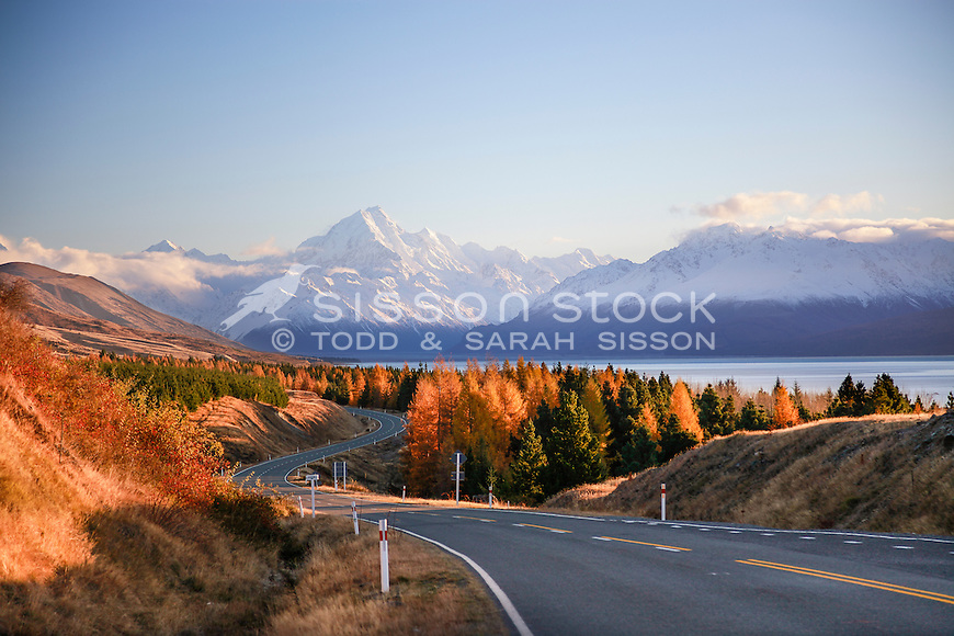 Winding road leads towards snow covered Mt Cook / Aoraki, Autumn, McKenzie Country