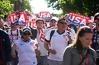 USA fans march from Occidental Park to Century Link Field before the USA Men's National Team's World Cup Qualifier against Panama in Seattle, WA on June 11, 2013.