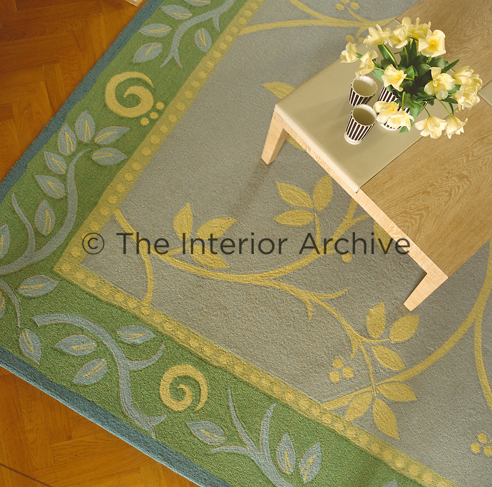 The spare and elegant lines of a coffee table on a contemporary rug