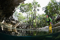RX0814-Dm. scuba diver (model released) about to explore inside a cenote, the magical entranceway to caverns and tunnels comprising an underground river system beneath the jungle. Riviera Maya, Yucatan Peninsula, Mexico.<br /> Photo Copyright &copy; Brandon Cole. All rights reserved worldwide.  www.brandoncole.com