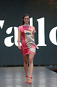 A model walks down the runway during the Wallo fashion show held during the Fashion and Design Festival  in downtown Montreal.