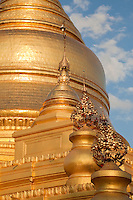 Myanmar, Burma, Mandalay.  Kuthodaw Temple, around which 729 marble slabs display the 15 books of the Tripitaka, each page housed in a separate stupa.  Construction began 1857.