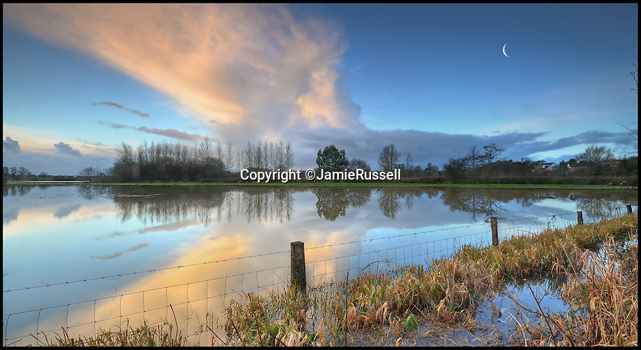 BNPS.co.uk (01202 558833)<br /> Pic: JamieRussell/BNPS<br /> <br /> ***Please Use Full Byline***<br /> <br /> Reflections in the flood water at Brading. <br /> <br /> Stunning photographs have revealed a turbulent side to the normally genteel Isle of Wight.<br /> <br /> The seemingly benign south coast holiday destination has been catalogued over a stormy year by local photographer Jamie Russell, and his astonishing pictures reveal the dramatic changes in weather that roll across the UK in just 12 months.<br /> <br /> Lightning storms, ice, floods, gales and blizzards have all been captured by the intrepid photographer who frequently got up in the middle of the night to capture the climatic chaos.<br /> <br /> Looking at these pictures prospective holidaymakers could be forgiven for thinking twice about a gentle staycation on the south coast island.