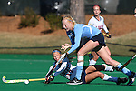 15 November 2014: North Carolina's Nina Notman (GER) (right) and Liberty's Ashlee Krulock (17). The University of North Carolina Tar Heels hosted the Liberty University Flames at Francis E. Henry Stadium in Chapel Hill, North Carolina in a 2014 NCAA Division I Field Hockey Tournament First Round game. UNC won the game 2-1.