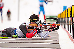 Canadian athlete David Gregoire takes aim in the prone position, at The International Biathlon Union Cup #6 Men's 10 KM Sprint held at the Canmore Nordic Center in Canmore Alberta, Canada, on Feb 12, 2012.  David finished in 36th position in the race.