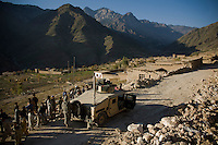 A Humvee guards a Shura meeting between soldiers from Delta-4, 1-26 Infantry and village elders from Shilam in the Pesh Valley. Delta-4, 1-26 Infantry visited elders in the village to hand out humanitarian aid via the Afghan National Army and maintain support in this pro-coalition village in a pro-Taliban area.