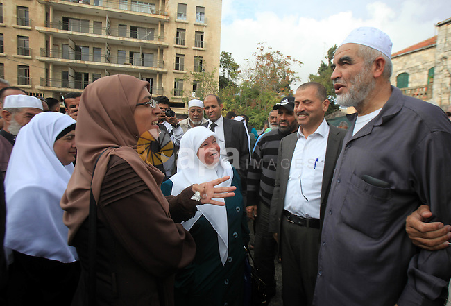 Leader of the radical northern wing of the Islamic Movement in Israel, Sheikh Raed Salah, speaks to supporters outside a Jerusalem court after he was convicted on October 27, 2015. An Israeli court upheld a conviction of the firebrand Islamic cleric and jailed him for 11 months for inciting violence over Jerusalem's Al-Aqsa mosque in 2007. Photo by Mahfouz Abu Turk