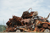 Daytime landscape view of damaged and rusting vehicles in a pile following the 311 Tohoku Tsunami in Funakoshi, Japan  © LAN