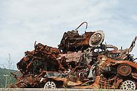 Daytime landscape view of damaged and rusting vehicles in a pile following the 311 Tohoku Tsunami in Funakoshi, Japan  © LAN