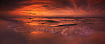 Colorful atmospheric panoramic nature scenery of red sunset over lake Huron. Ontario, Canada. Pinery Provincial Park.