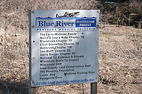 A sign notes conservation progress on the Blue River in the Driftless Area of southwest Wisconsin.