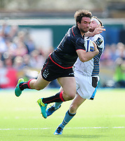 Marcelo Bosch of Saracens is tackled by Finn Russell of Glasgow Warriors. European Rugby Champions Cup Quarter Final, between Saracens and Glasgow Warriors on April 2, 2017 at Allianz Park in London, England. Photo by: Patrick Khachfe / JMP