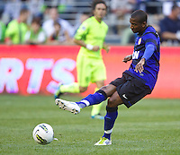 Manchester United forward Ashley Young passes the ball during play against the Seattle Sounders FC at CenturyLink Field in Seattle Wednesday July 20, 2011. Manchester United won the match 7-0.
