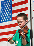 ROXBURY CT. 11 July 2015-071115SV03-Rory McNamara, 8, of Washington plays a song during the annual Pickin' 'N' Fiddlin' fundraiser at Hurlburt Park in Roxbury Saturday.<br /> Steven Valenti Republican-American