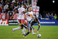 Thierry Henry (14) of the New York Red Bulls fouls David Beckham (23) of the Los Angeles Galaxy. The New York Red Bulls defeated the Los Angeles Galaxy 2-0 during a Major League Soccer (MLS) match at Red Bull Arena in Harrison, NJ, on October 4, 2011.