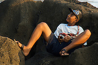 Balines Boy and his Cellphone at Tanah Lot Beach