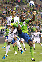 Seattle Sounders FC defender Jhon Kennedy Hurtado , right, kicks the ball over the head of Vancouver Whitecaps FC  midfielder \37\ during play at Qwest Field in Seattle Saturday June 11, 2011. The game ended in a 2-2 draw.