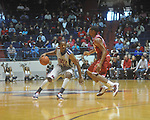 "Ole Miss guard Zach Graham (32) drives against Arkansas' Marcus Britt (12) at C.M. ""Tad"" Smith in Oxford, Miss. on Saturday, March 5, 2010. (AP Photo/Oxford Eagle, Bruce Newman)"