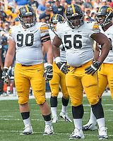 Iowa defensive lineman Louis Trinca-Pasat (90) and Faith Ekakitie (56) await the next play. Iowa Hawkeyes defeated the Pitt Panthers 24-20 at Heinz Field, Pittsburgh Pennsylvania on September 20, 2014.