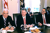 United States President Bill Clinton, center, meets Speaker of the U.S. House of Representatives Tom Foley (Democrat of Washington), left, and U.S. Senate Majority Leader George J. Mitchell (Democrat of Maine), right, in the Cabinet Room of the White House in Washington, D.C. on March 2, 1993..Credit: Jeff Markowitz / Pool via CNP