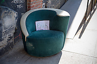 A free chair by Bogart Avenue in the Bushwick neighborhood of Brooklyn in New York on Saturday, April 27, 2013. The neighborhood is undergoing gentrification changing from a rough and tumble mix of Hispanic and industrial to a haven for hipsters, forcing many of the long-time residents out because of rising rents. (© Frances M. Roberts)