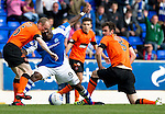 St Johnstone v Dundee United....01.09.12      SPL  .Gregory Tade battles with Gavin Gunning and Willo Flood.Picture by Graeme Hart..Copyright Perthshire Picture Agency.Tel: 01738 623350  Mobile: 07990 594431