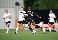 Esther Anyanwu (14) of the Virginia Beach Piranhas passes the ball off during the game at the University of Mary Washington Battleground Stadium in Fredericksburg, VA.   The Virginia Beach Piranhas defeated the Fredericksburg Impact, 2-0, in a weather shortened game.