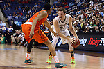 12 March 2015: Notre Dame's Pat Connaughton (24) and Miami's James Palmer (left). The Notre Dame Fighting Irish played the University of Miami Hurricanes in an NCAA Division I Men's basketball game at the Greensboro Coliseum in Greensboro, North Carolina in the ACC Men's Basketball Tournament quarterfinal game. Notre Dame won the game 70-63.