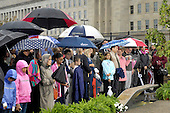Washington, DC - September 11, 2009 -- Families who suffered the loss of a relative in the September 11, 2001, terrorist attack on the Pentagon gather under rainy skies to participate in a memorial ceremony, September 11, 2009, marking the 8th anniversary of the attack.  At 9:37 a.m. on that fateful day, American Airlines Flt. 77, a Boeing 757 flying out of Dulles International bound for Los Angeles, was hijacked by terrorists and deliberately crashed into the Pentagon killing all 59 people aboard and 125 Pentagon workers. .Mandatory Credit: Robert D. Ward - DoD via CNP