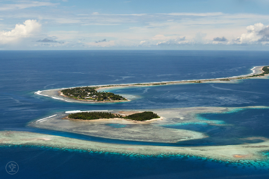 From the air the islands that make up Jaluit Atoll are simply slivers of land in the Pacific. Marhsall Islands, Micronesia.