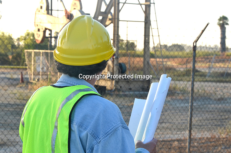 Stock Photo Project Manager Inspecting Oil Field