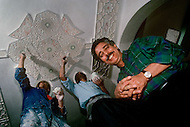 March 9, 1989, Casablanca, Morocco. Art craft master under a painted ceiling made by his team. The Hassan II Mosque was widely decorated with such fine art craft pieces. The mosque was completed in 1993.