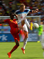 Motion blur of Divock Origi of Belgium and Vasiliy Berezutskiy of Russia
